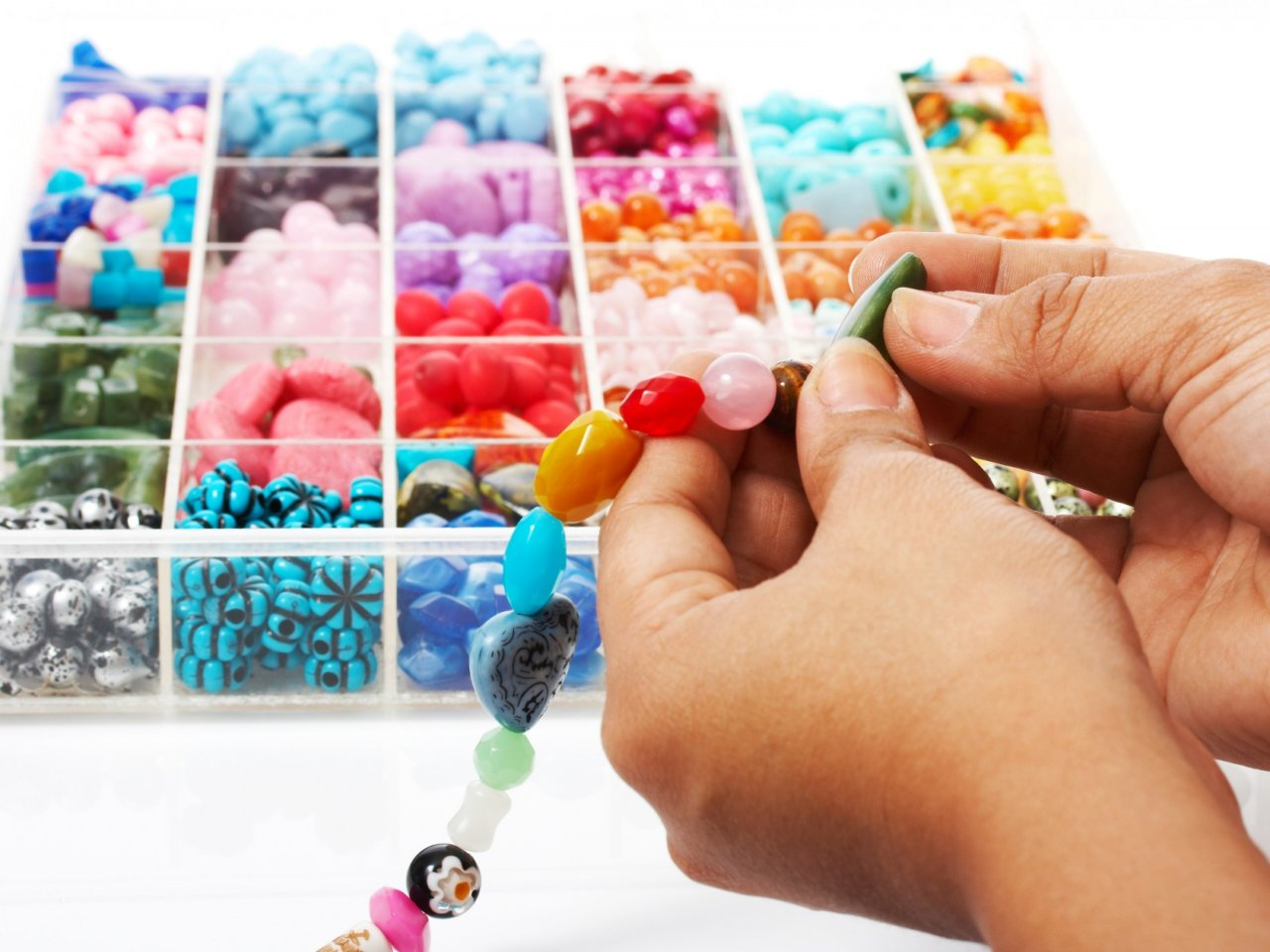 Selecting Beads In An Assortment Of Colors For A Beautiful Unique Necklace
